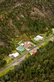 Houses on the outskirts of Queenstown Tasmania. Queenstown, Tasmania, Australia, Ocotber 10, 2013: Aerial view of houses on the outskirts of the small west coast royalty free stock photography