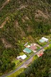 Houses on the outskirts of Queenstown Tasmania. Queenstown, Tasmania, Australia, Ocotber 10, 2013: Aerial view of houses on the outskirts of the small west coast royalty free stock images