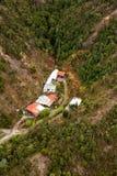 Houses on the outskirts of Queenstown Tasmania. Queenstown, Tasmania, Australia, Ocotber 10, 2013: Aerial view of houses on the outskirts of the small west coast stock photos