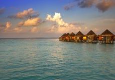 Houses over the sea at sunrise. Maldives Stock Image
