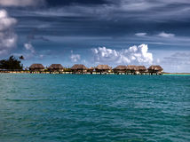 Houses over the transparent quiet sea water Royalty Free Stock Image