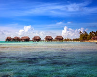 Houses over the transparent quiet sea water Stock Photo