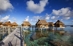 Houses over the transparent quiet sea water Stock Photography