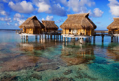 Houses over the transparent quiet sea water.Close up in a sunny day Stock Image