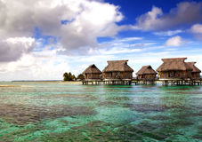 Houses over the transparent quiet sea water Stock Photos