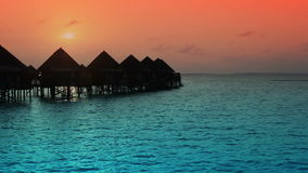 Houses over the transparent quiet sea water on a sunset stock video footage