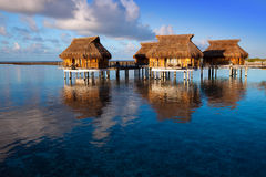 Houses over the transparent quiet sea water on a sunset.water landscape in a sunny day Stock Images