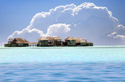 Houses over transparent quiet sea water- tropical paradise, Maldives Stock Photography