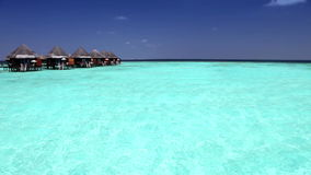 Houses over transparent quiet sea water- tropical paradise, Maldives stock video footage