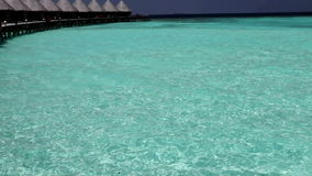 Houses over transparent quiet sea water- tropical paradise, Maldives stock video