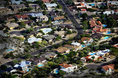 Houses from Overhead Aerial Neighborhood Development. Homes houses from high overhead aerial neighborhood development swimming pools and streets Royalty Free Stock Image
