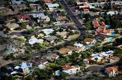 Houses from Overhead Aerial Neighborhood Development. Homes houses from high overhead aerial neighborhood development swimming pools and streets Royalty Free Stock Image