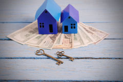 Houses from the paper with keys and money Stock Image