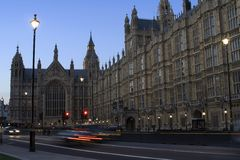 Houses of Parliament. At night with car light trails Royalty Free Stock Image