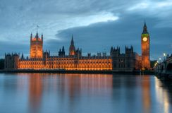 Houses of Parliament. Reflects in the Thames in London, UK Stock Images