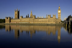 Houses of parliament. In london reflected in the river thames stock photography