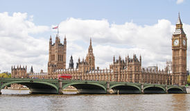 Houses of Parliament. The Houses of Parliament in London with Westminster Bridge passing in front of it and acrosss the River Thames. An iconic Red Bus is stock image