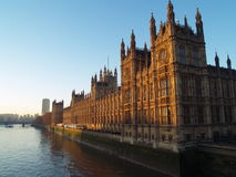 Houses of Parliament. Reflections of sunlight at dawn in Houses of Parliament in a freeze winter morning Royalty Free Stock Photo