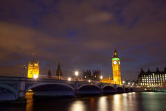 Houses of parliament. With Big Ben at night with river thames and Westminster bridge stock image