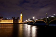 Houses of parliament. With Big Ben at night with river thames and Westminster bridge stock photo