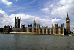 Houses of Parliament. The Houses of Parliament of  the United Kingdom on the banks of the Thames River Stock Images