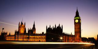 The Houses of Parliament. Westminster Bridge and the Houses of Parliament. The historic Buildings are illuminated and the sky is lit blue and pink in the royalty free stock photos