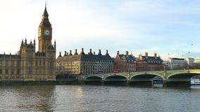 Houses Of Parliament And Big Ben With Boat Passing Through Thames River In London, UK. Houses Of Parliament And Big Ben With Boat Passing Through Thames River stock video
