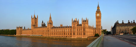 Houses of Parliament & Big Ben Panorama from Westminster Bridge. The London Houses of Parliament & Big Ben Panorama in early morning from Westminster Bridge Stock Photo
