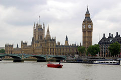 Houses of Parliament, Big Ben, and Thames River. A view of the English Houses of Parliament, Big Ben, Westminster Bridge, and the Thames River in London Stock Photos