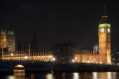 Houses of Parliament, Big Ben and Westminster Bridge at night in Stock Photos