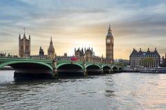 Houses of Parliament, Big Ben and Westminster bridge at sunset, London, UK Stock Photos