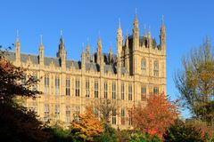 Houses of Parliament and coloured bushes Stock Images