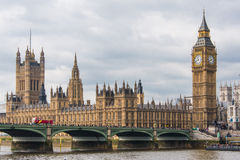 Houses of Parliament with the Elizabeth Tower - Big Ben. This is a view of the Houses of Parliament in London, United Kingdom. This also shows the Clock or Stock Photos