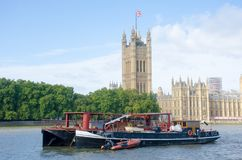 Houses of Parliament with Large Boat. In the foreground Stock Photo