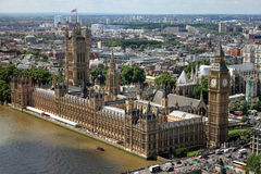 Houses Of Parliament London Aerial View. An aerial view of the Houses Of Parliament, situated in London. The River Thames and Westminister Bridge are visible at stock photography