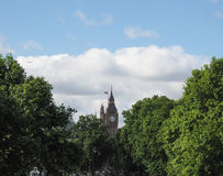 Houses of Parliament in London. Houses of Parliament aka Westminster Palace seen from Victoria Embankment in London, UK Royalty Free Stock Photo