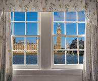 Houses of Parliament in London. Houses of Parliament aka Westminster Palace in London, UK seen from a window Stock Photo