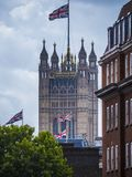 The houses of Parliament London and the British flag Royalty Free Stock Photography