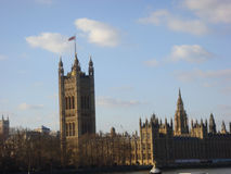 The Houses of Parliament, London, England. Image of the Houses of Parliament in London, England.  Blue skies and light clouds in the background Stock Image