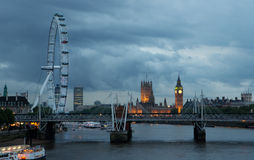 Houses of Parliament and london eye. Byt the river thames early evening stock photos