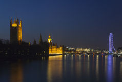 Houses of Parliament and the London Eye at night Royalty Free Stock Photography
