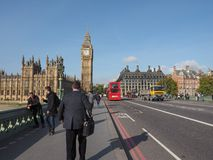 Houses of Parliament in London. LONDON, UK - SEPTEMBER 28, 2015: Tourists on Westminster Bridge at the Houses of Parliament aka Westminster Palace Stock Photos