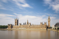 Houses Of Parliament Long Exposure. Long exposure panorama of the Houses of Parliament in London with blue sky and the Westminster Bridge to the right stock images
