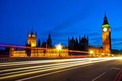 Houses of Parliament at night. Night shot of the Houses of Parliament   showing traffic light trails over Westminster Bridge and Big Ben Stock Photos