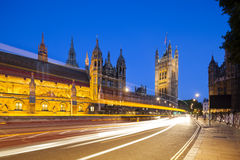 Houses Of Parliament At Night. Long exposure night shot of the Houses of Parliament in London with blue sky and a street in the foreground Royalty Free Stock Images