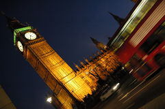 London red bus and The Houses of Parliament at night Stock Photos
