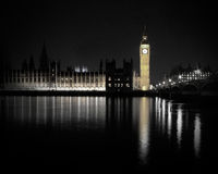 Houses of parliament at night with reflection in water. Royalty Free Stock Images