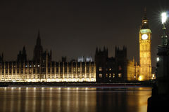 Houses of Parliament at Night. A night view across the River Thames at Westminster, London, England, UK, showing Big Ben and the Houses of Parliament floodlit Stock Photo