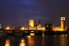 Houses of Parliament at night. Night view of The palace of Westminster including the Houses of Parliament and Big Ben shot over the River Thames with Westminster stock images