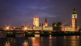 Houses of Parliament at night. Night view of the seat of UK government, The Houses of Parliament, viewed from across the River Thames and with Westminster Bridge Stock Photos